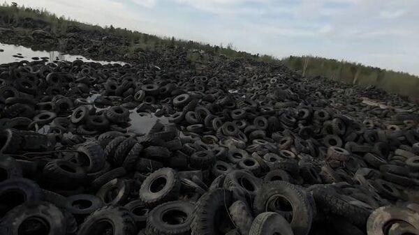 Кадры гигантской свалки резиновых автопокрышек под Нижневартовском