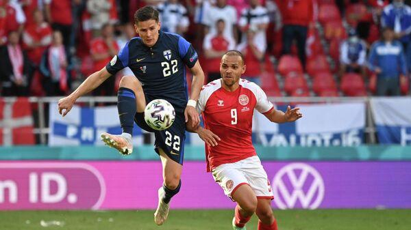 Игровой момент матча Дания - Финляндия