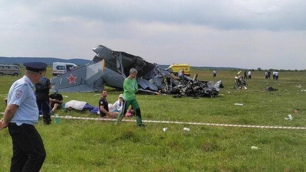 На месте крушения самолета Л-410 в Кемеровской области. Стоп-кадр видео