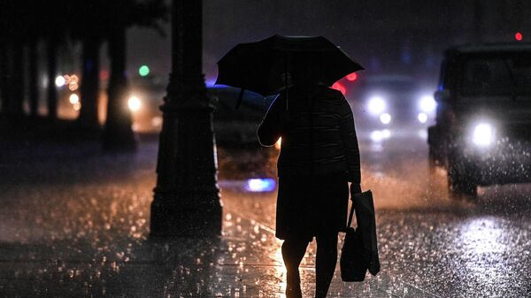 Женщина во время дождя