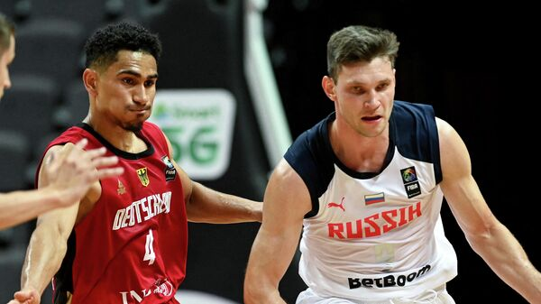Russia's Ivan Ukhov (R) fights for the ball with Germany's Maodo Lo  during the FIBA Men's Olympic Qualifying Tournament match between Russial and Germany, on July 1, 2021, in Split. (Photo by Denis LOVROVIC / AFP)