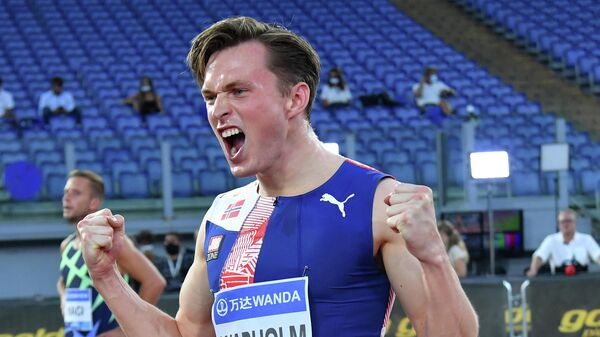 Norway's Karsten Warholm celebrates after wins in the men's 400mt Hurdles final during the IAAF Diamond League competition on September 17, 2020 at the Olympic stadium in Rome. (Photo by Andreas SOLARO / AFP)