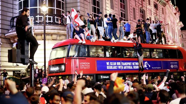 FILE PHOTO: Soccer Football - Euro 2020 - Fans gather for England v Denmark - Piccadilly Circus, London, Britain - July 7, 2021 England fans celebrate after the match REUTERS/Henry Nicholls/File Photo