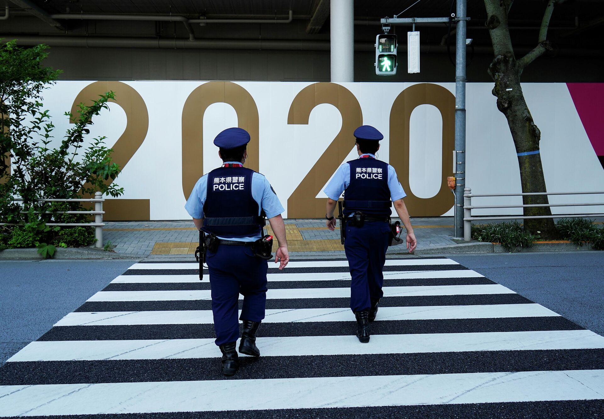 Сотрудники полиции на улицах Токио в преддверии старта Олимпийских игр - РИА Новости, 1920, 19.07.2021