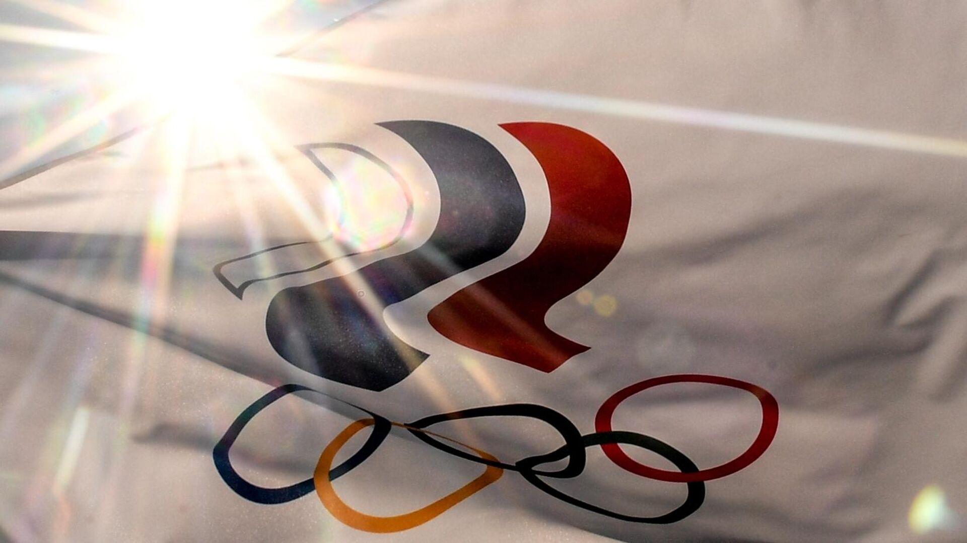 Флаг с символикой Олимпийских игр в Токио - РИА Новости, 1920, 24.07.2021