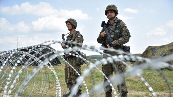 Военнослужащие на тактических учениях Три меча-2021 (Three swords-2021) с участием вооружённых сил Украины и стран НАТО на Яворовском полигоне во Львовской области