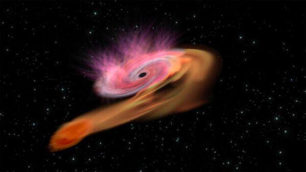 Явление приливного разрушения звезды при прохождении вблизи черной дыры в представлении художника