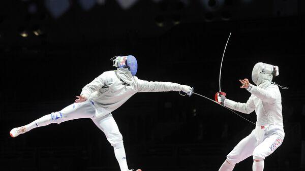 О Сан Ук (слева) в финале Олимпиады