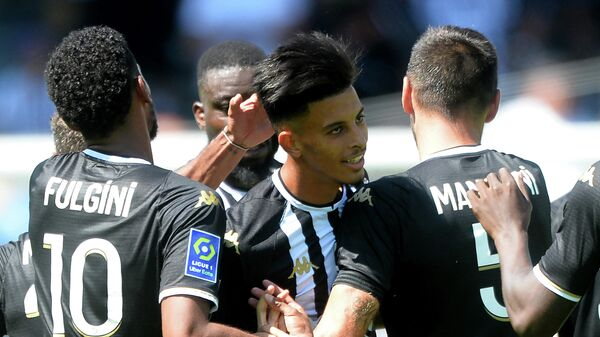 Angers' French midfielder Azzedine Ounahi (C) celebrates with teammates after he scored a third goal for his team, during the French L1 football match between Angers SCO and Olympique Lyonnais, at the Raymond-Kopa Stadium, in Angers, western France, on August 15, 2021. (Photo by JEAN-FRANCOIS MONIER / AFP)