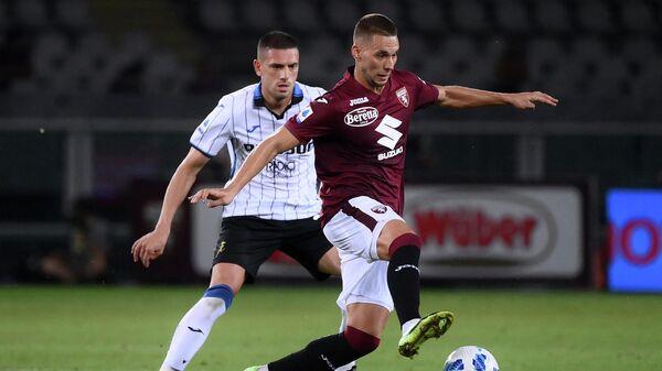 Футболисты Мерих Демирал и Марко Пьяца в матче Торино - Аталанта