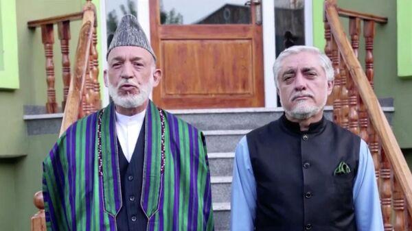 Бывший президент Афганистана Хамид Карзай и глава совета по нацпримирению Абдулла Абдулла