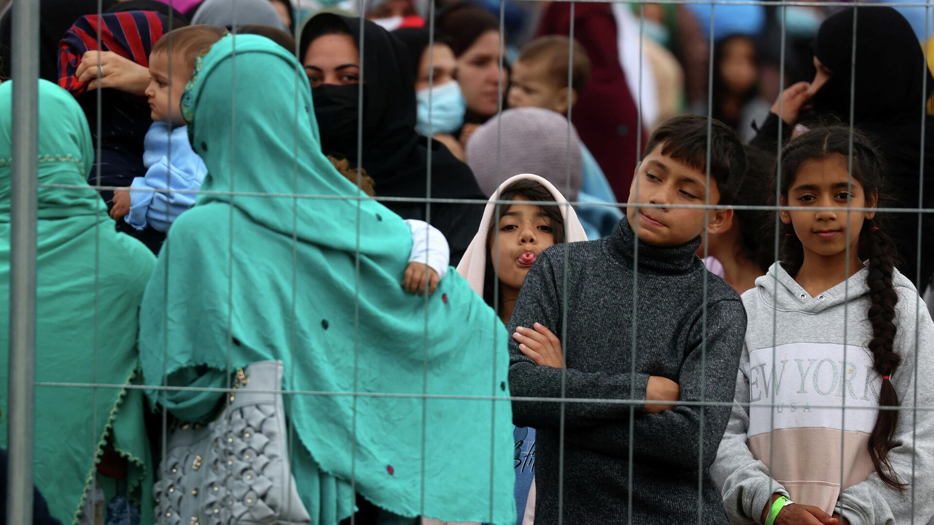 Беженцы из Афганистана, эвакуированные в город Кайзерслаутерн, Германия  - РИА Новости, 1920, 03.09.2021