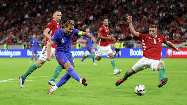 Soccer Football - World Cup - UEFA Qualifiers - Group I - Hungary v England - Puskas Arena, Budapest, Hungary - September 2, 2021 England's Harry Kane shoots at goal as Hungary's Willi Orban attempts to block REUTERS/Carl Recine