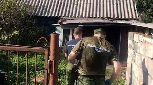 Работа следователей на месте обнаружения тел школьниц в Кузбассе