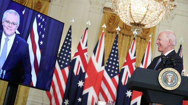 Президент США Джо Байден во время переговоров с премьер-министром Австралии Скоттом Моррисоном в Белом доме в Вашингтоне