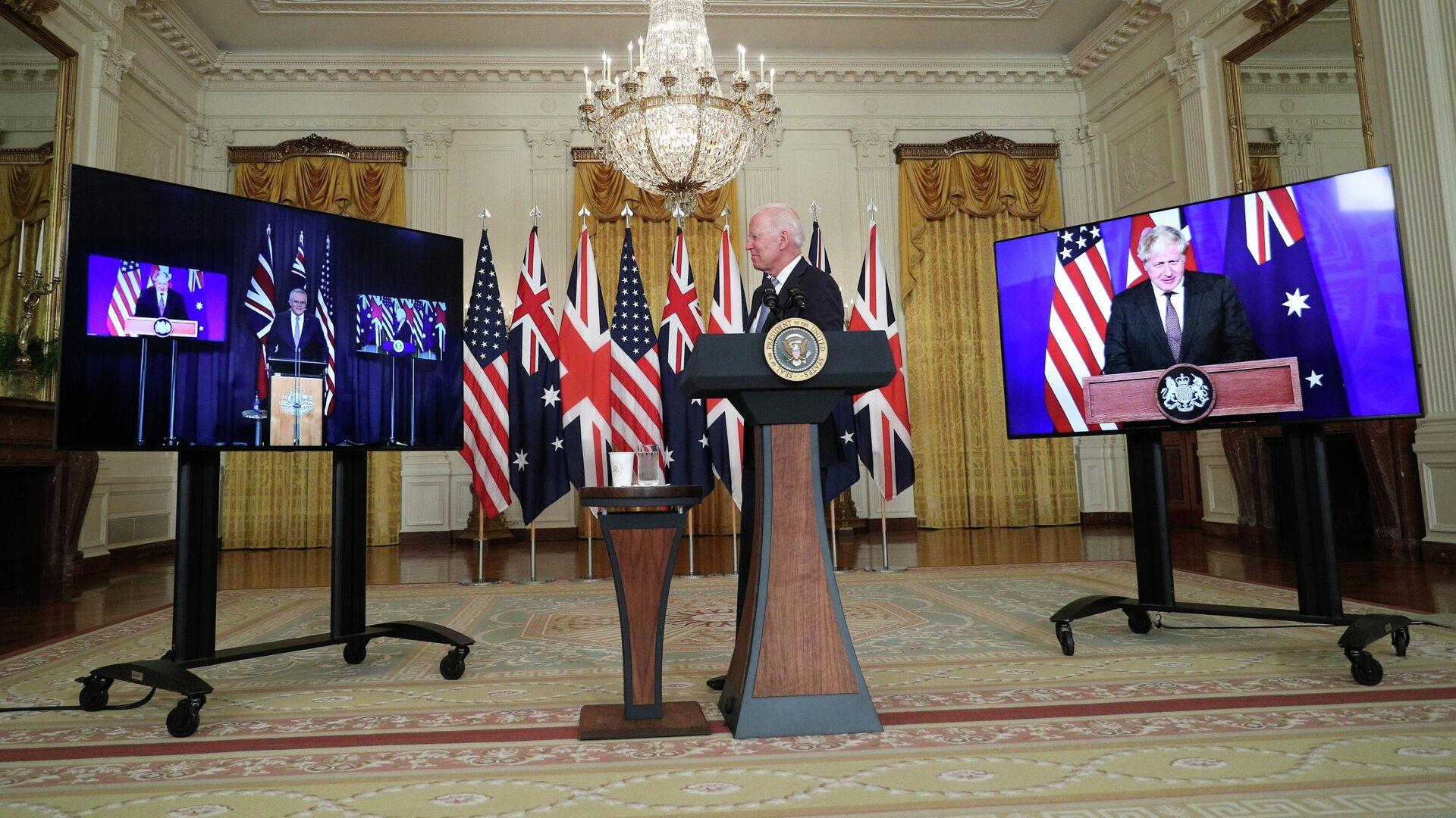 Президент США Джо Байден во время переговоров с премьер-министром Австралии Скоттом Моррисоном и премьер-министром Великобритании Борисом Джонсоном в Белом доме в Вашингтоне - РИА Новости, 1920, 20.09.2021
