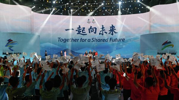 'Together for a Shared Future' is displayed during the launch ceremony of the slogan for the Beijing 2022 Olympic and Paralympic Games in Beijing on September 17, 2021. (Photo by WANG Zhao / AFP)