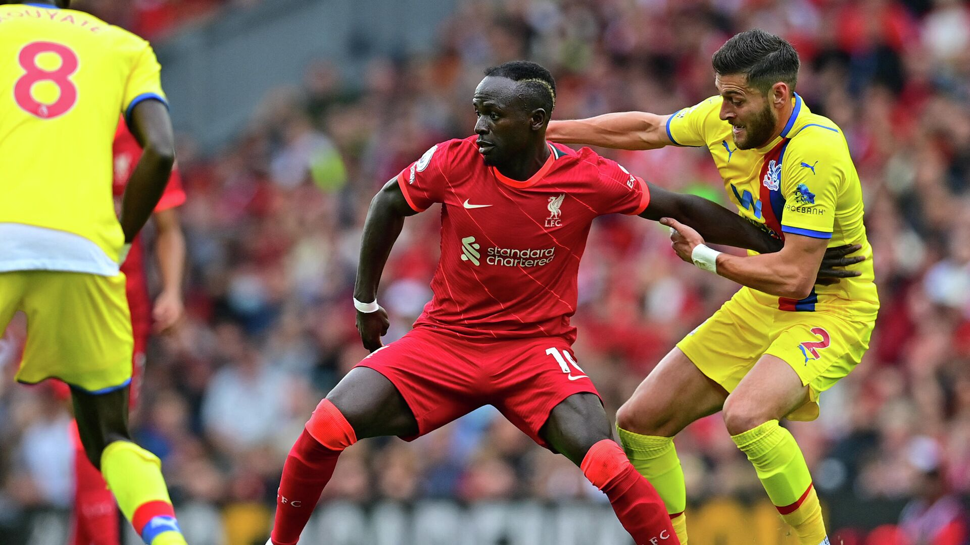 Liverpool's Senegalese striker Sadio Mane (C) vies with Crystal Palace's English defender Joel Ward (R) during the English Premier League football match between Liverpool and Crystal Palace at Anfield in Liverpool, north west England on September 18, 2021. (Photo by Paul ELLIS / AFP) / RESTRICTED TO EDITORIAL USE. No use with unauthorized audio, video, data, fixture lists, club/league logos or 'live' services. Online in-match use limited to 120 images. An additional 40 images may be used in extra time. No video emulation. Social media in-match use limited to 120 images. An additional 40 images may be used in extra time. No use in betting publications, games or single club/league/player publications. /  - РИА Новости, 1920, 18.09.2021