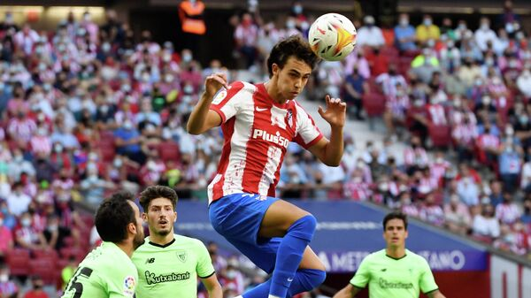 Atletico Madrid's Portuguese midfielder Joao Felix heads the ball during the Spanish League football match between Club Atletico de Madrid and Athletic Club Bilbao at the Wanda Metropolitano stadium in Madrid on September 18, 2021. (Photo by PIERRE-PHILIPPE MARCOU / AFP)