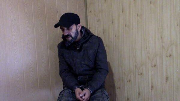 Допрос подозреваемого в сотрудничестве с украинскими правоохранителями