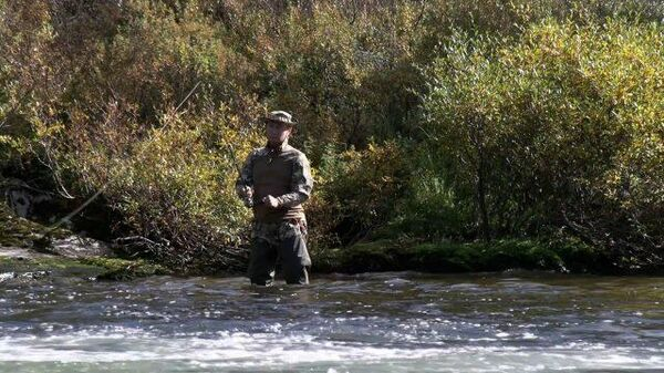 Палатка, костер и рыбалка: отпуск Путина в сибирской тайге