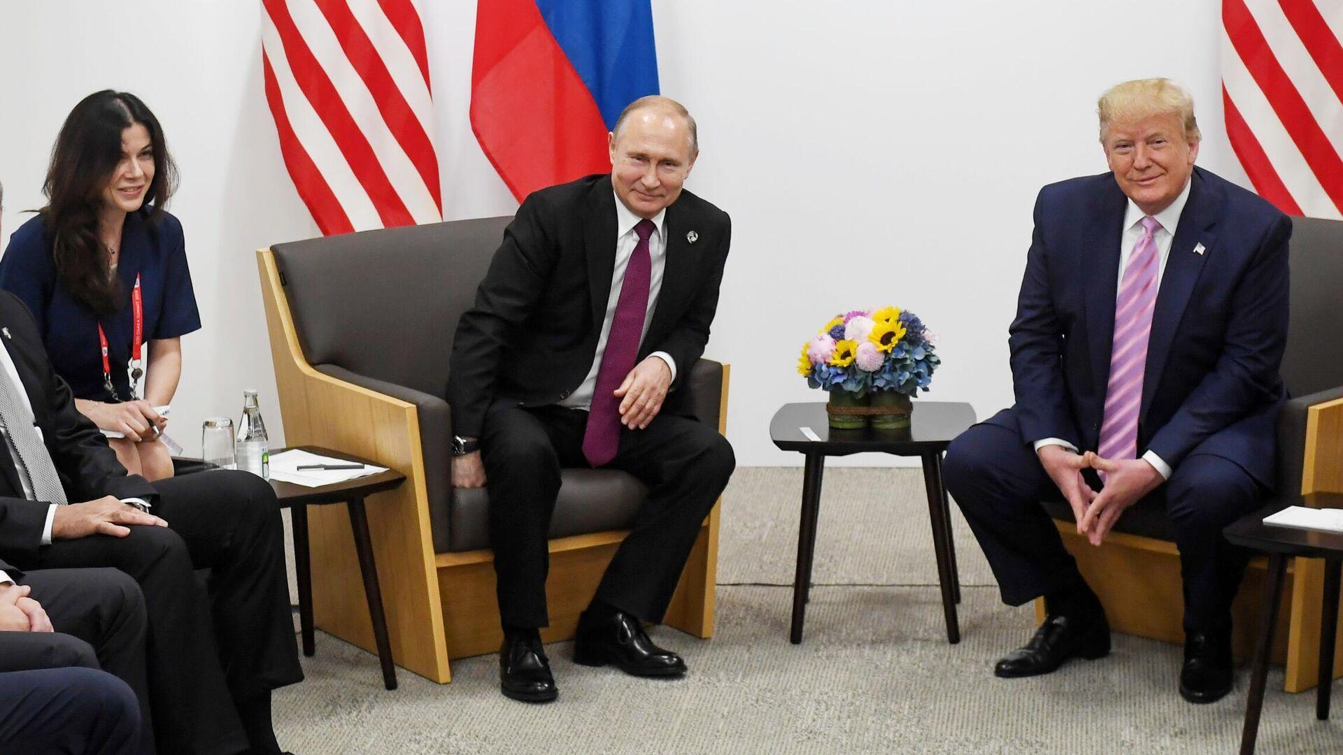 Президент РФ Владимир Путин и президент США Дональд Трамп во время встречи на полях саммита Группы двадцати в Осаке - РИА Новости, 1920, 29.09.2021