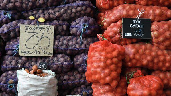 Продажа овощей на сельскохозяйственной ярмарке