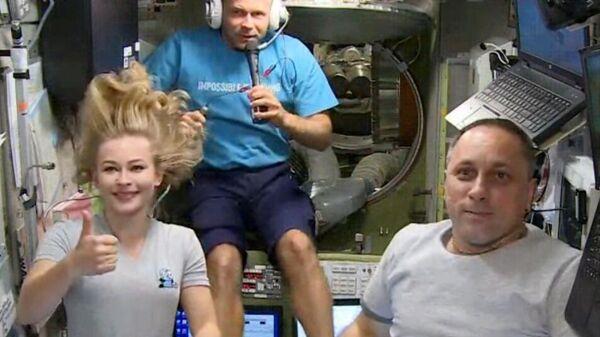 Актриса Юлия Пересильд, режиссер Клим Шипенко и космонавт Антон Шкаплеров на Международной космической станции