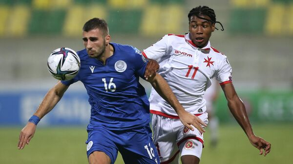 Soccer Football - World Cup - UEFA Qualifiers - Group H - Cyprus v Malta - AEK Arena - George Karapatakis, Larnaca, Cyprus - October 11, 2021 Cyprus' Costas Soteriou in action with Malta's Paul Mbong REUTERS/Yiannis Kourtoglou