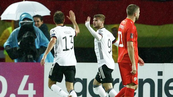 Soccer Football - World Cup - UEFA Qualifiers - Group J - North Macedonia v Germany - Toshe Proeski Arena, Skopje, North Macedonia - October 11, 2021 Germany's Timo Werner and Thomas Muller celebrate their first goal scored by Kai Havertz REUTERS/Ognen Teofilovski