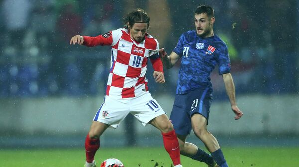 Soccer Football - World Cup - UEFA Qualifiers - Group H - Croatia v Slovakia - Stadion Gradski vrt, Osijek, Croatia - October 11, 2021  Croatia's Luka Modric in action with Slovakia's Matus Bero REUTERS/Antonio Bronic