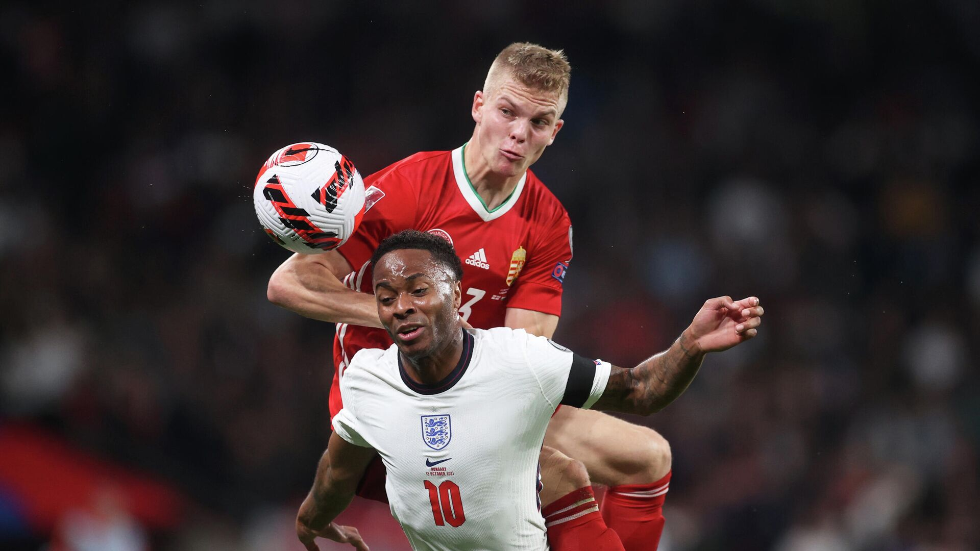 Soccer Football - World Cup - UEFA Qualifiers - Group I - England v Hungary - Wembley Stadium, London, Britain - October 12, 2021 Hungary's Andras Schafer in action with England's Raheem Sterling Action Images via Reuters/Carl Recine - РИА Новости, 1920, 13.10.2021