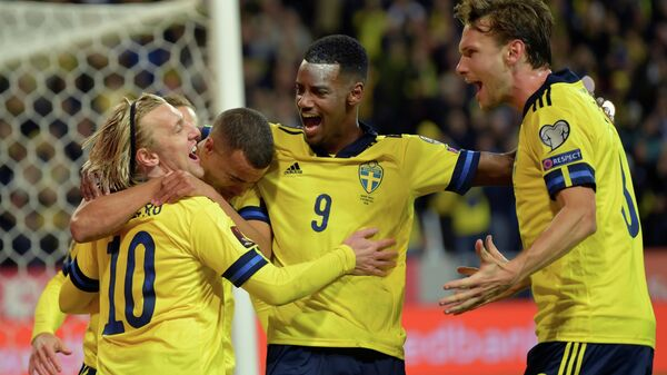 Soccer Football -  World Cup - UEFA Qualifiers - Group B - Sweden v Greece - Friends Arena, Stockholm, Sweden - October 12, 2021 Swedens' Emil Forsberg celebrates scoring their first goal with teammates  Anders Wiklund/TT News Agency via REUTERS     ATTENTION EDITORS - THIS IMAGE WAS PROVIDED BY A THIRD PARTY. SWEDEN OUT. NO COMMERCIAL OR EDITORIAL SALES IN SWEDEN.