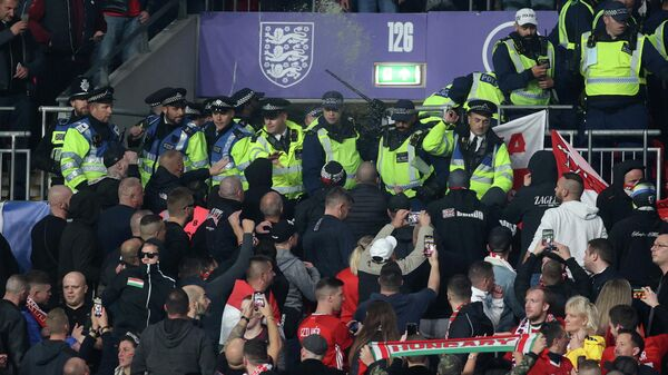 Soccer Football - World Cup - UEFA Qualifiers - Group I - England v Hungary - Wembley Stadium, London, Britain - October 12, 2021 General view as Police clash with Hungary fans during the match Action Images via Reuters/Carl Recine     TPX IMAGES OF THE DAY
