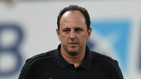 Flamengo's coach Rogerio Ceni gestures during the Carioca Championship 2021 final match agaist Fluminense at the Maracana stadium, in Rio de Janeiro, Brazil, on May 22, 2021, which is played behind closed doors as a mesure to combat COVID-19 coronavirus pandemic. (Photo by MAURO PIMENTEL / AFP)