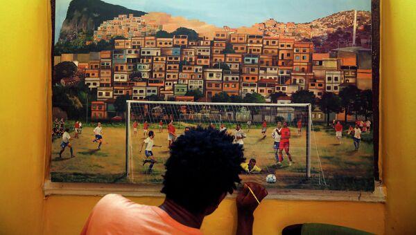 Художник рисует картину игры в футбол в Рио-де-Жанейро, Бразилия