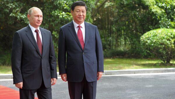 Президент России Владимир Путин и председатель Китайской народной республики Си Цзиньпин. Архивное фото