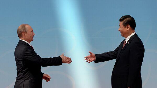 Президент России Владимир Путин и председатель Китайской народной республики Си Цзиньпин. Архивное фото.