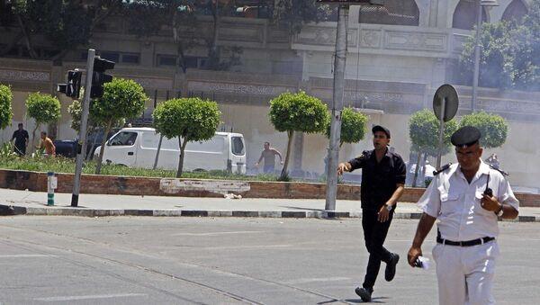 На месте взрыва в Каире. 30 июня 2014