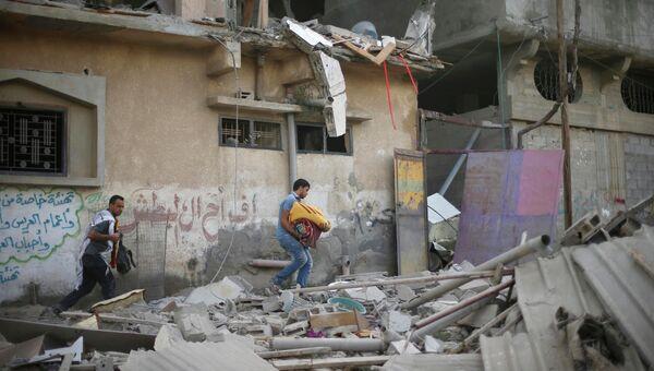 Последствия обстрела сектора Газы 15 июля 2014. Архивное фото