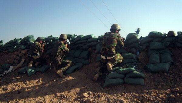 Курдские силы безопасности занимают позиции районе Таза, к югу от богатого нефтью города Киркук, Ирак