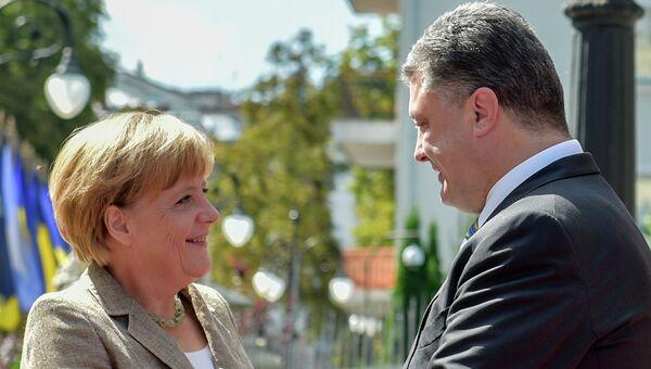 Петр Порошенко с Ангела Меркель. Архивное фото