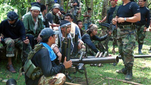 Боевики филиппинской террористической организации Абу Сайяф (Abu Sayyaf). Архивное фото