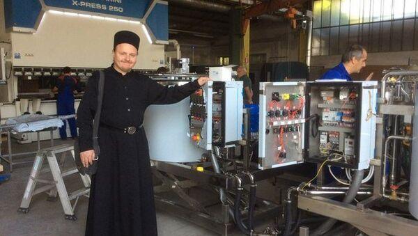 Монах Валаамского монастыря осматривает оборудование для монастырской сыроварни
