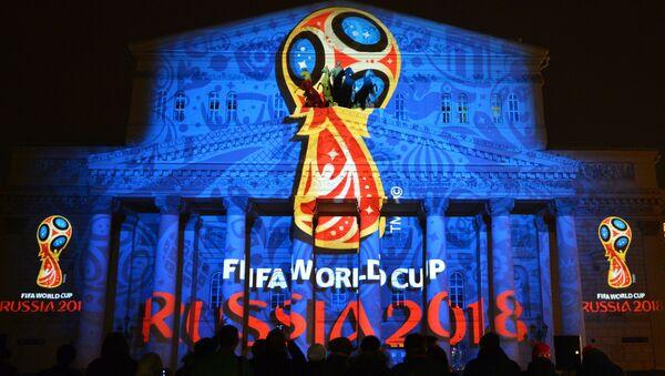 Проекция официального логотипа чемпионата мира 2018 по футболу на фасаде Государственного академического Большого театра. Архивное фото