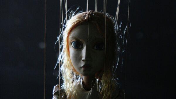 Кукла-марионетка, архивное фото