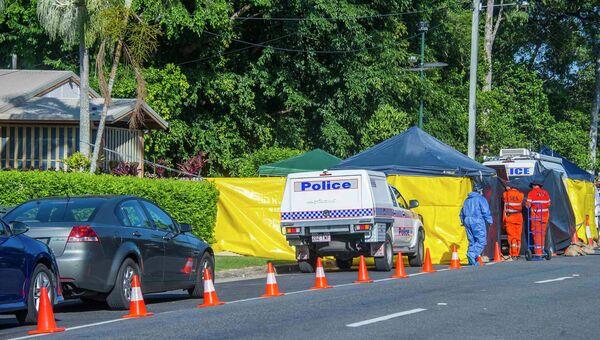 Полиция работает на месте убийства восьми детей в Кэрнсе, штат Квинсленд, Австралия, 19 декабря 2014