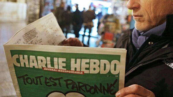 Первый после теракта номер номер французского сатирического еженедельника Charlie Hebdo