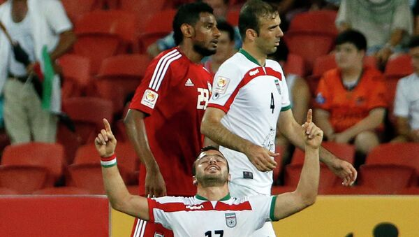 Игрок сборной Ирана по футболу Соруш Рафи радуется победе своей команды. 19 января 2015
