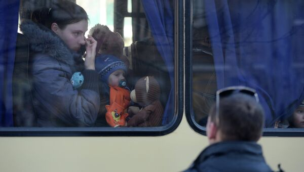 Беженцы в салоне автобуса. Архивное фото